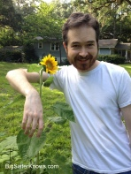 Robby with his volunteer sunflower. (Photo by Ashley Jones, 2015)
